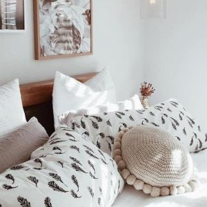 Closely Knit Soleil Pom Pom Cushion | Latte