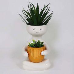 Person Holding A Pot Planter